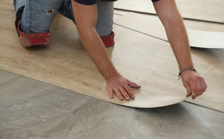 Man Installing Luxury Vinyl Flooring